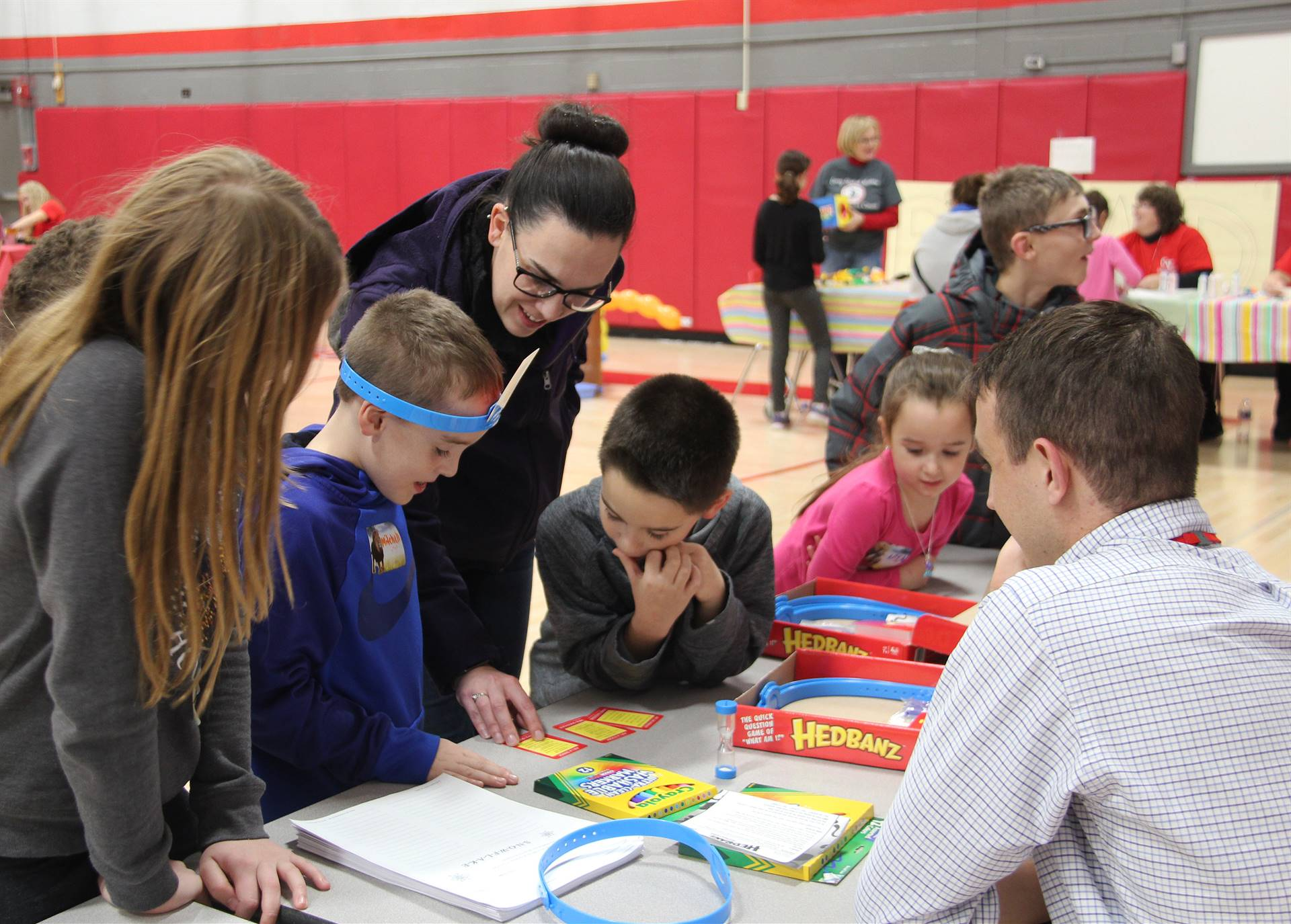 students and adults playing game