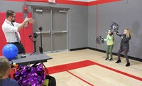 students taking part in slow motion photo booth