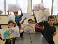 students holding up thanksgiving pictures