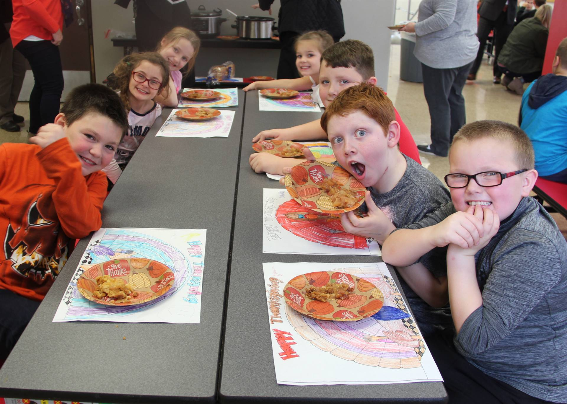 students at lunch table with thanksgiving treats