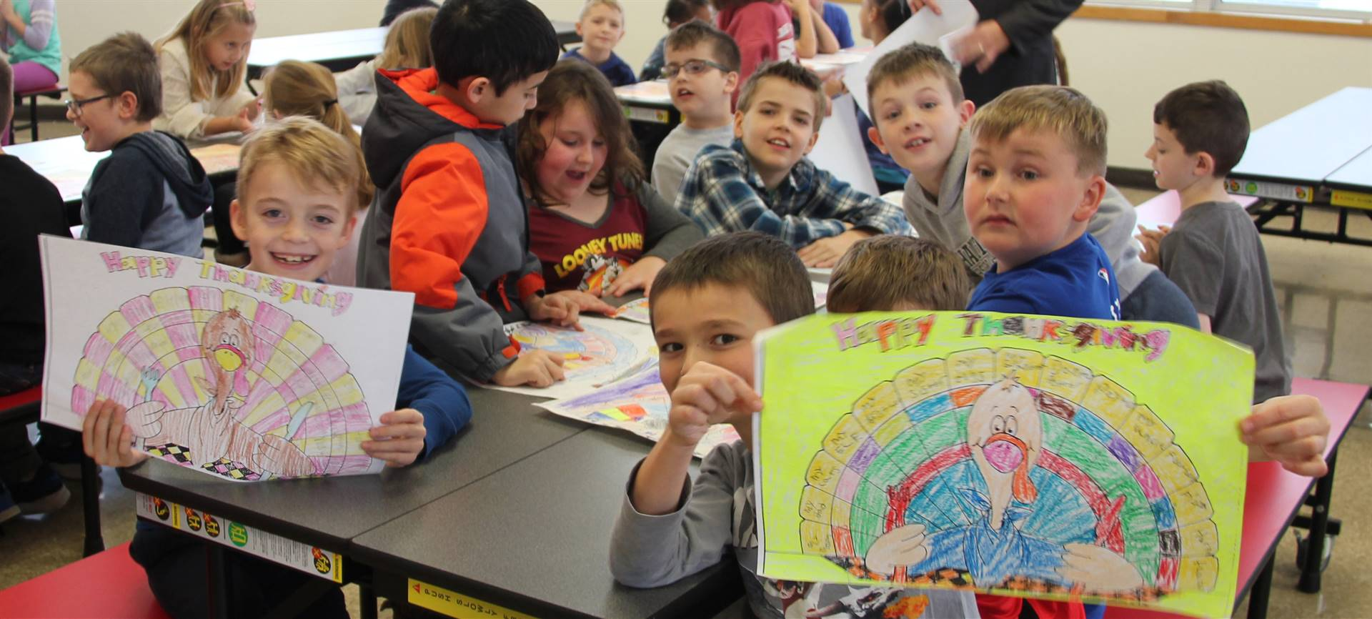 more students holding up thanksgiving pictures