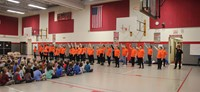 wide shot of students performing for p d students