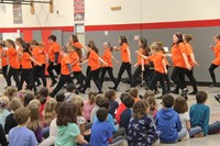 students performing for p d students
