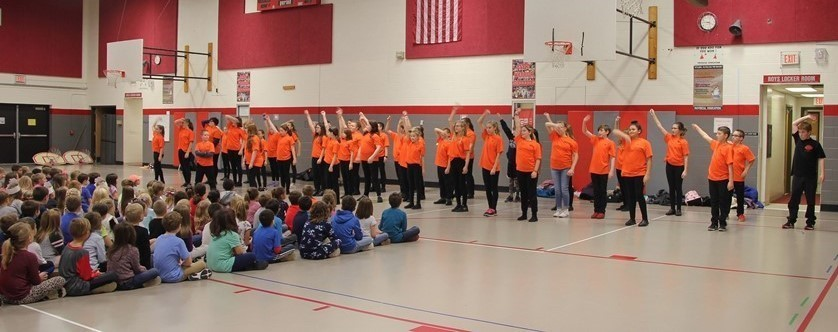 middle school students giving sneak peek of musical for elementary students