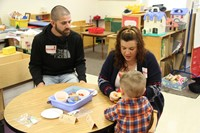 man and woman with boy at pre k family day