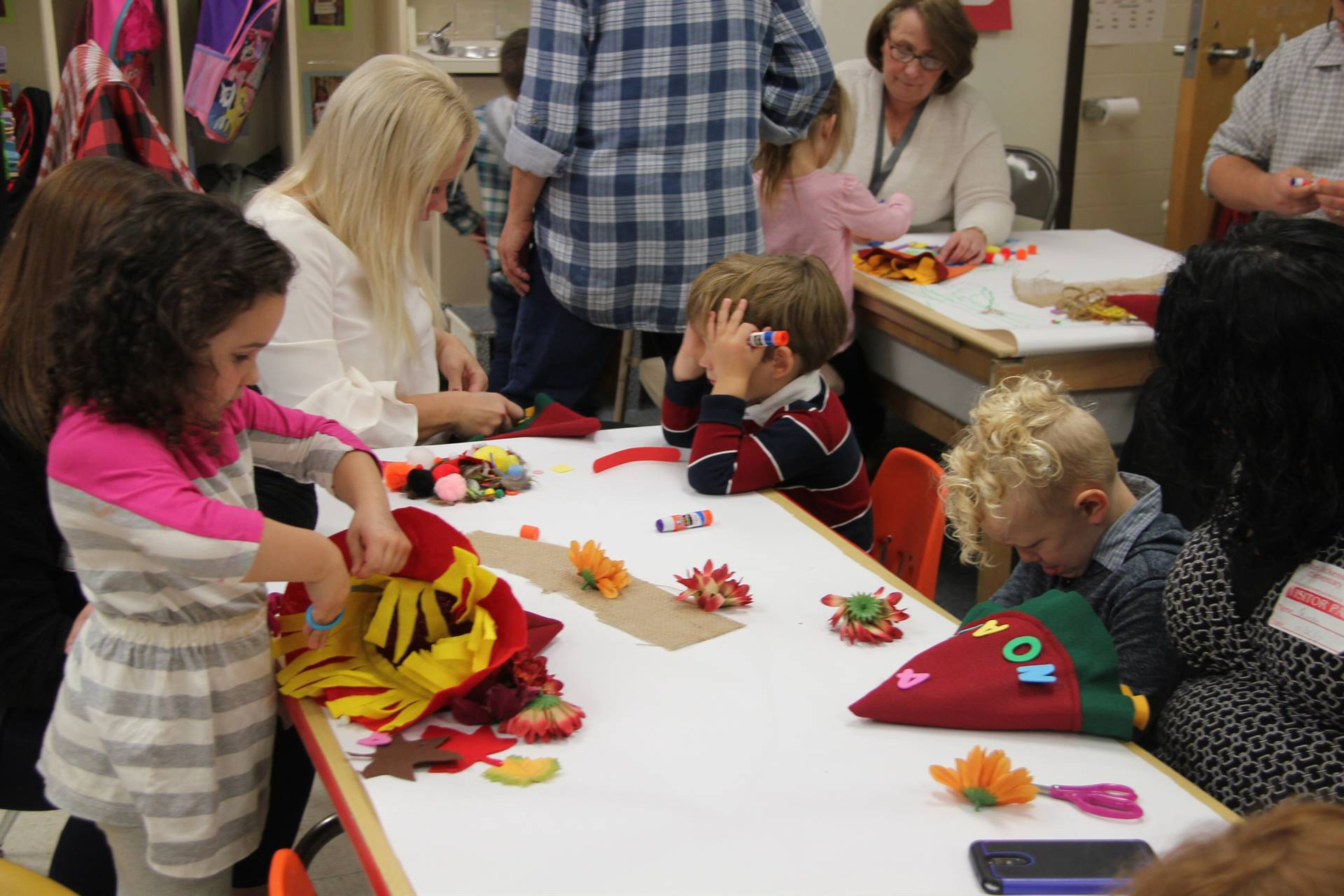 pre k students working hard to create scarecrow hats