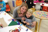 woman and boy smile at pre k family day