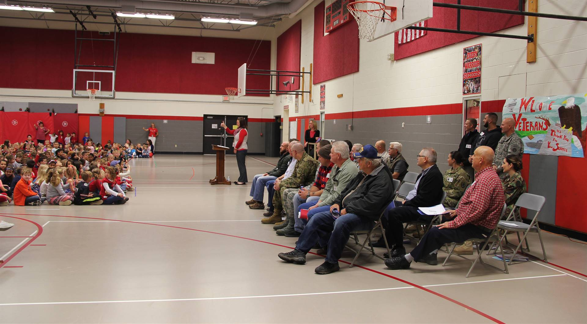 wide shot of gym with students and veterans