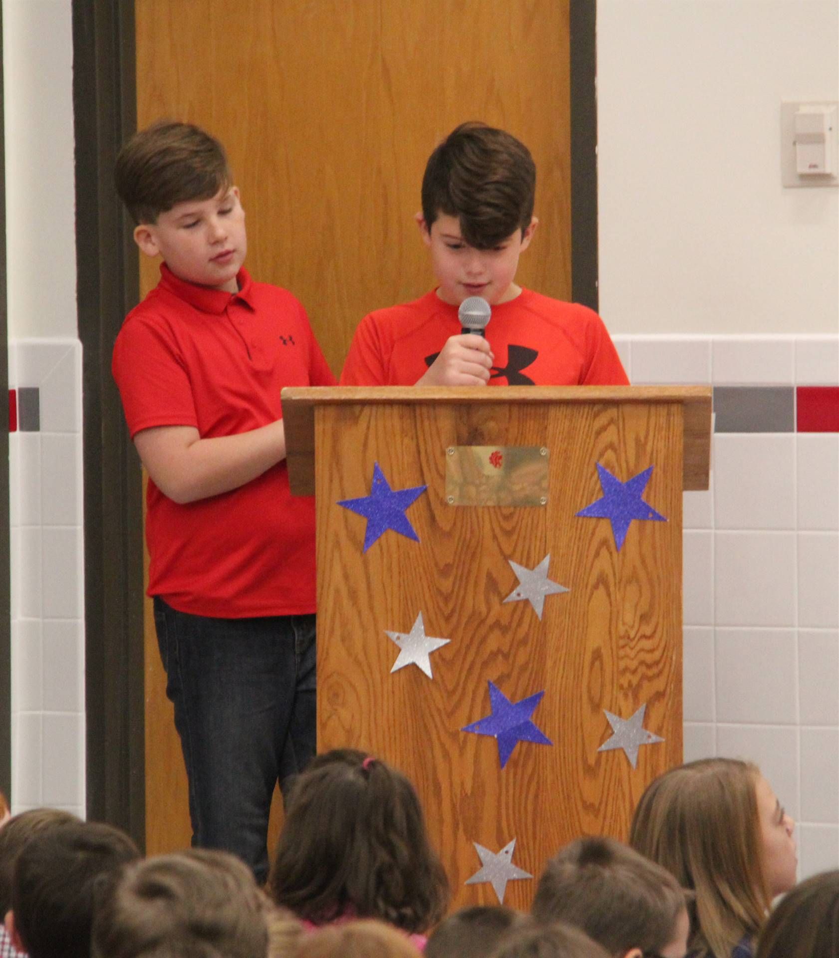 up close of student speaking at veterans day assembly