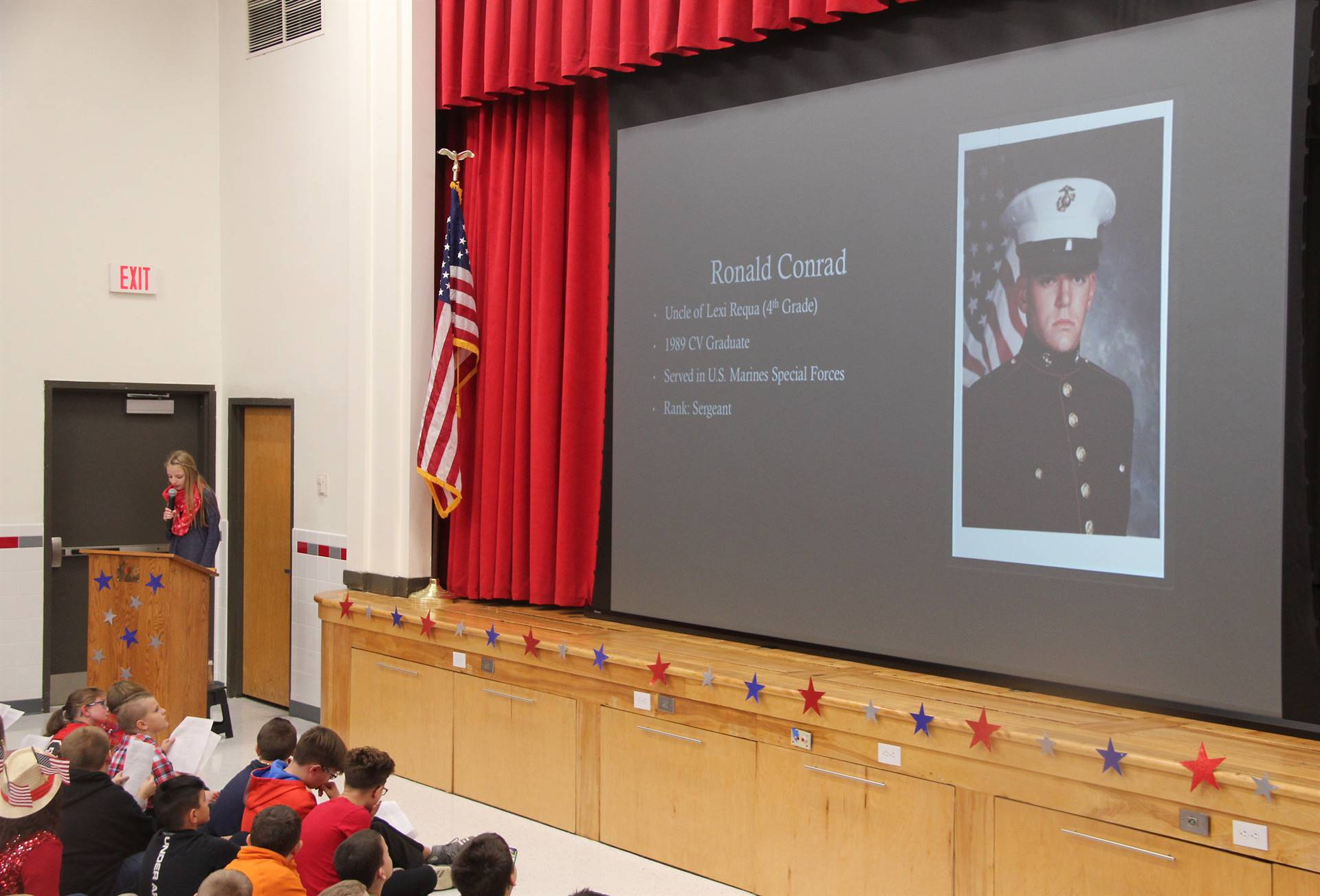 student reading poem during veterans day assembly