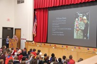 students speaking during veterans day assembly