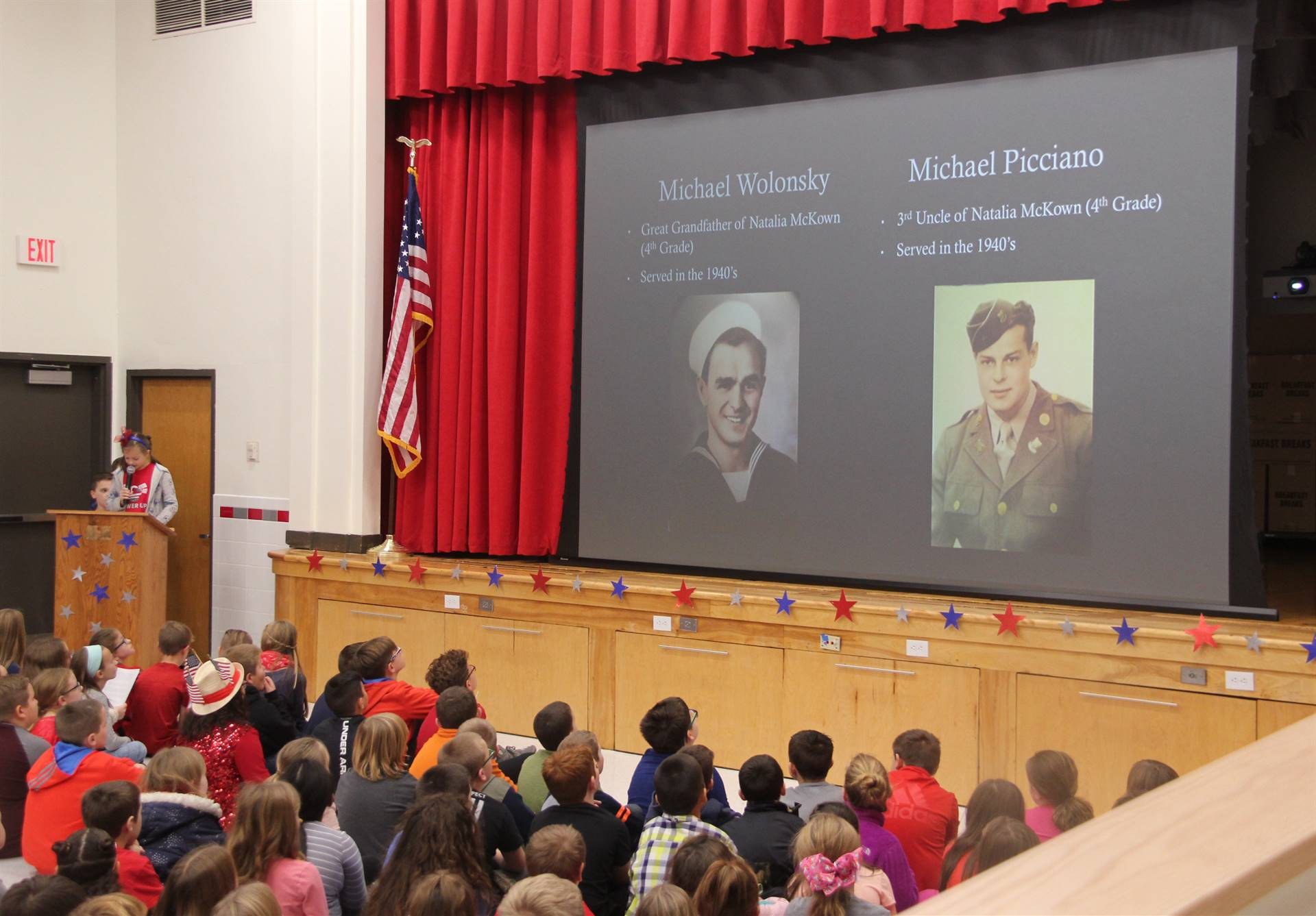 student speaking at veterans day assembly