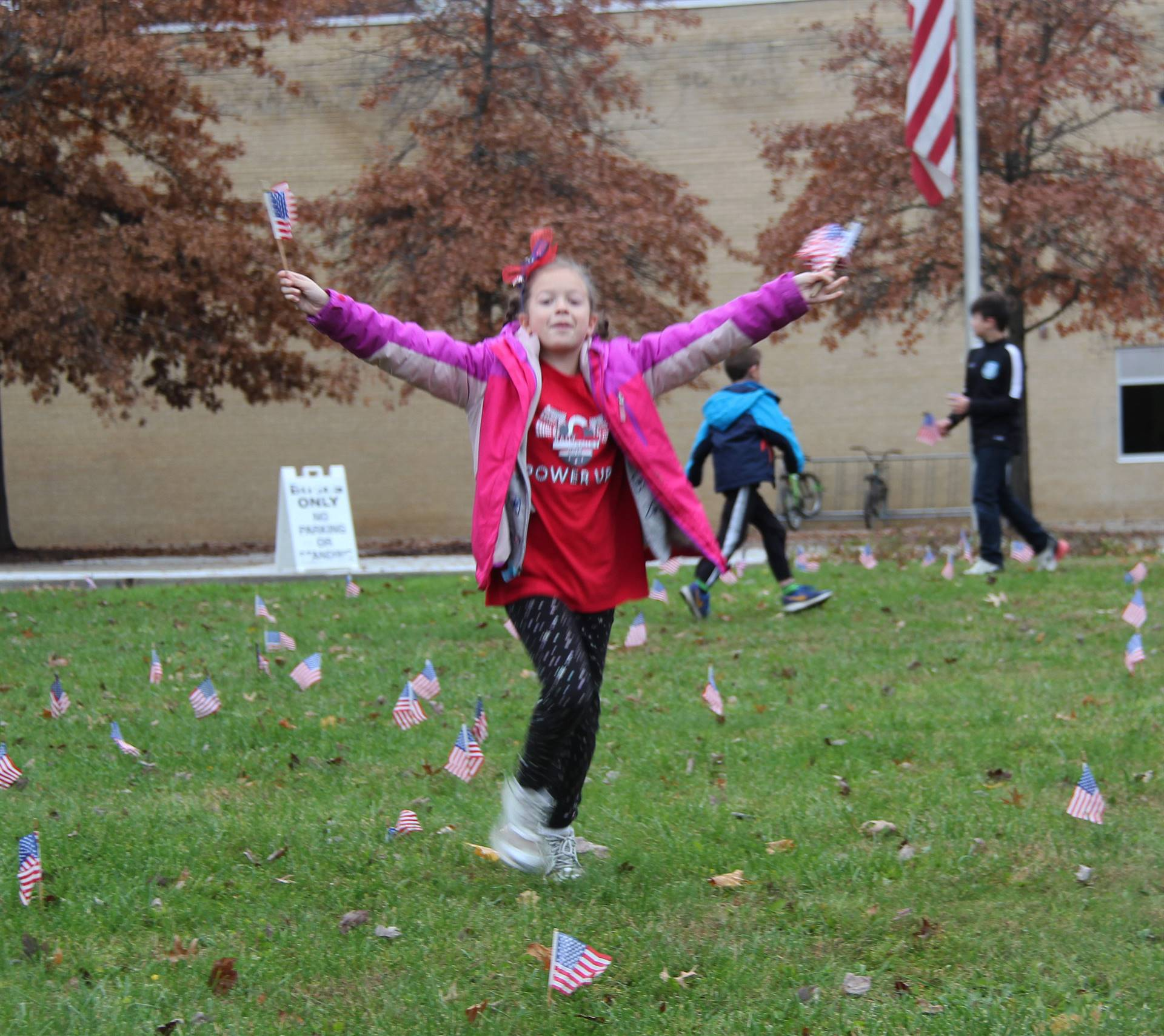 student holding flags in the air