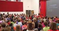 students and staff saying the pledge of allegiance