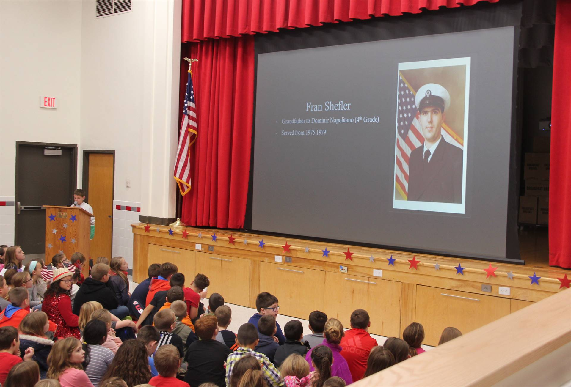 student speaking in front of peers at chenango bridge veterans day assembly