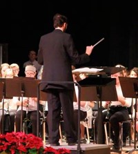 instructor conducting band students