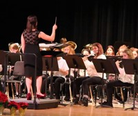 students playing instruments and instructor conducting