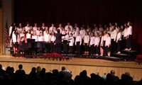 medium shot of seventh and eighth grade chorus on stage