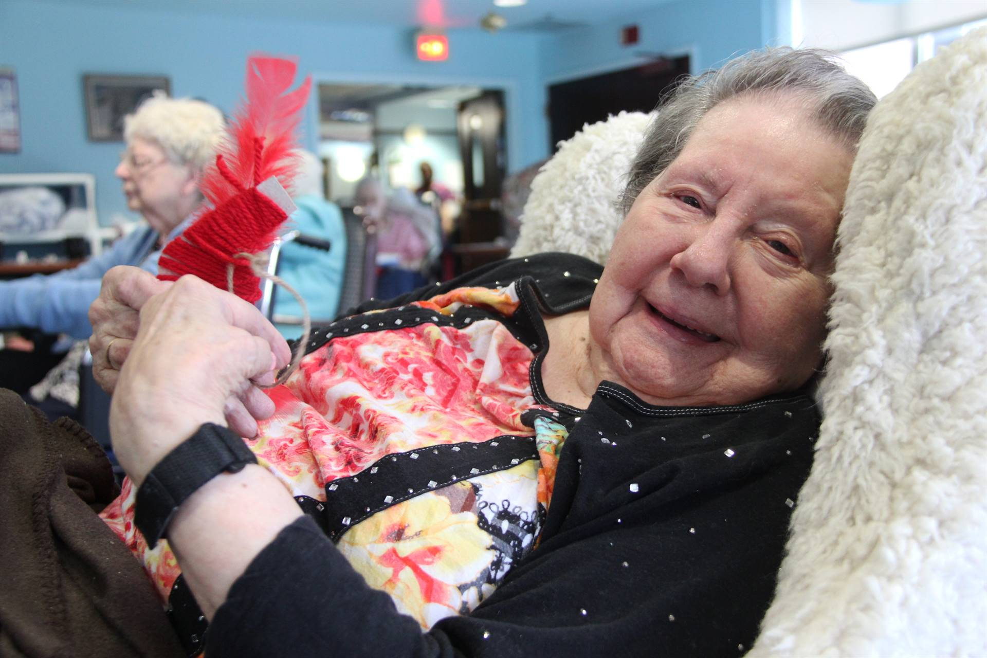resident smiling holding ornament