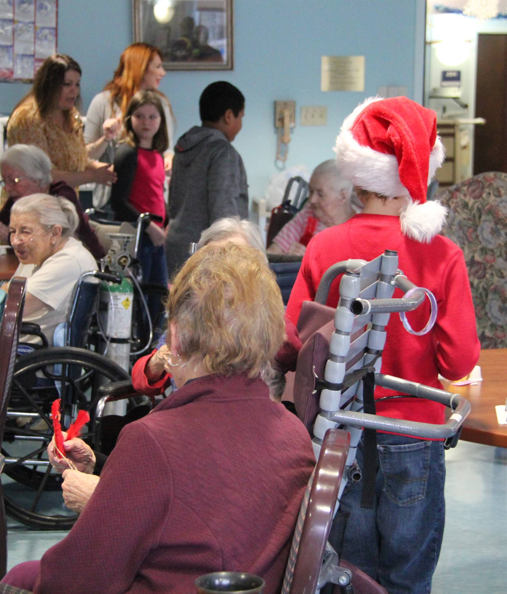 students giving residents ornaments