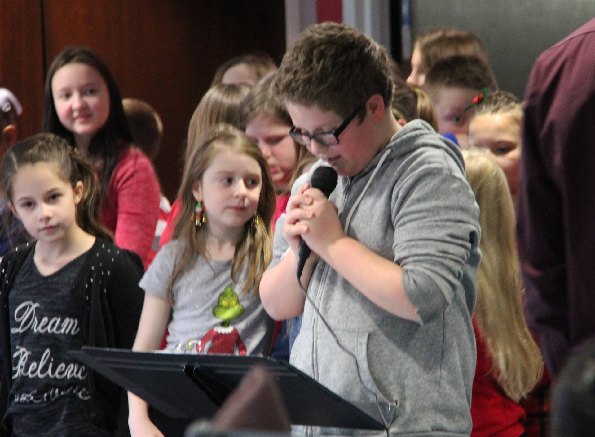 student speaking into microphone