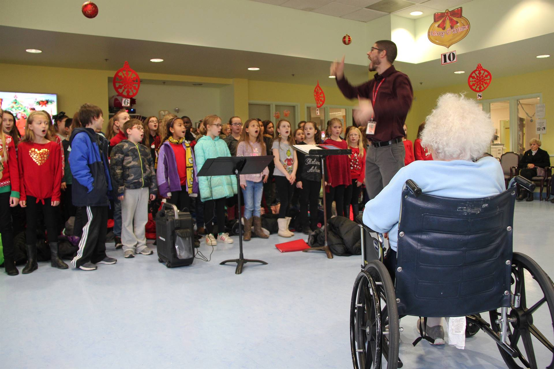 students singing for residents