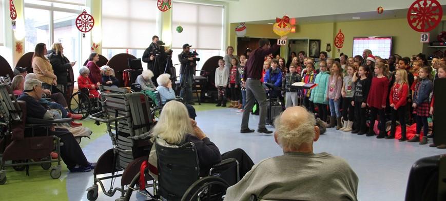 students singing at senior living center