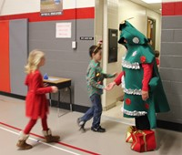 principal dressed as tree saying bye to students