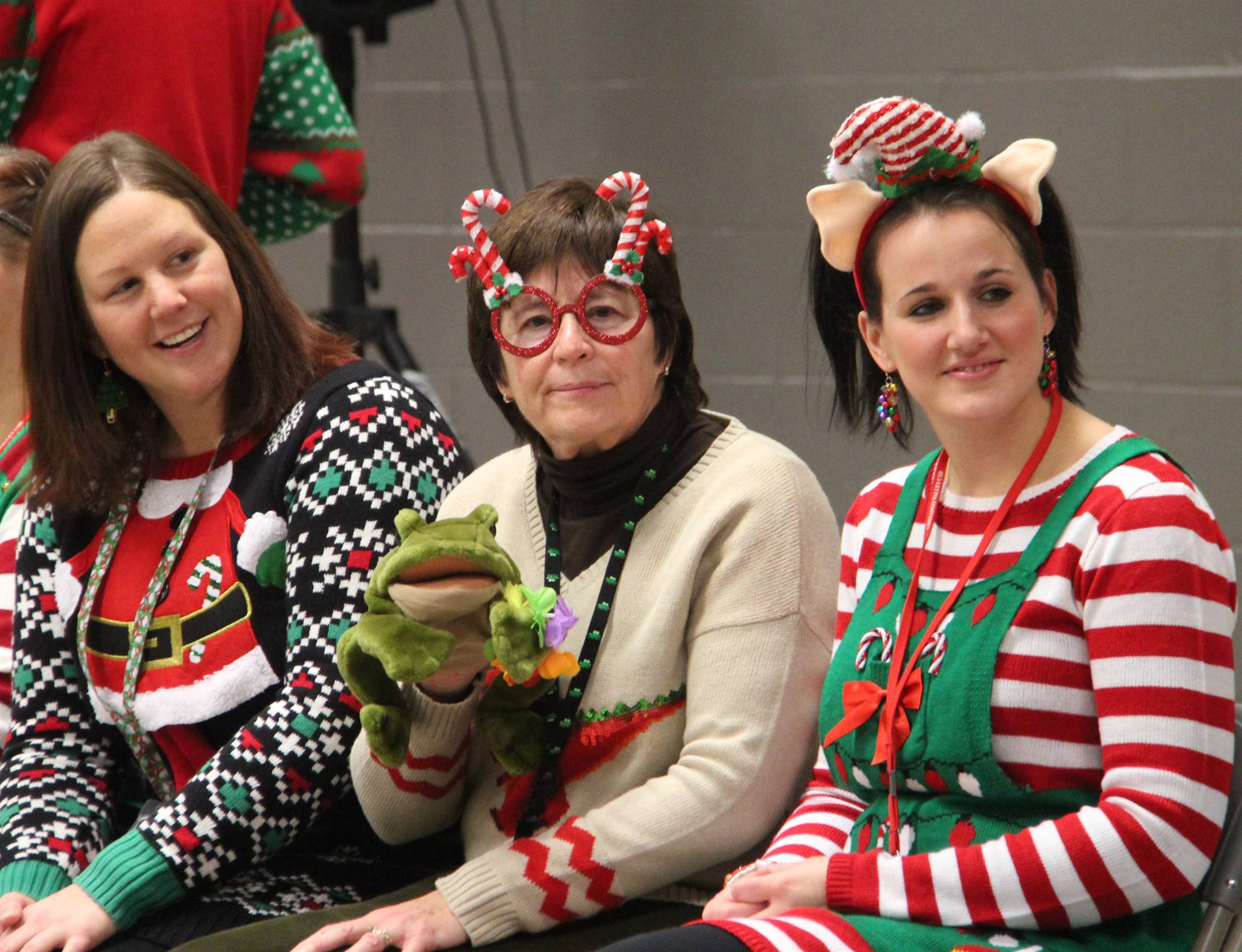 three teachers dressed festively