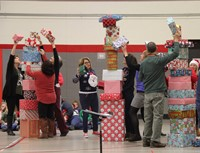teachers participating in present stacking game