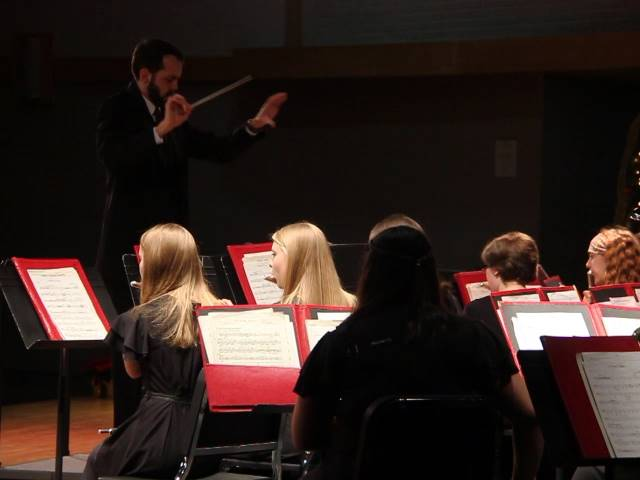 teacher conducting students
