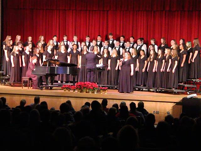 medium wide shot of chorus performing