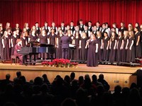 wide shot of students singing in chorus