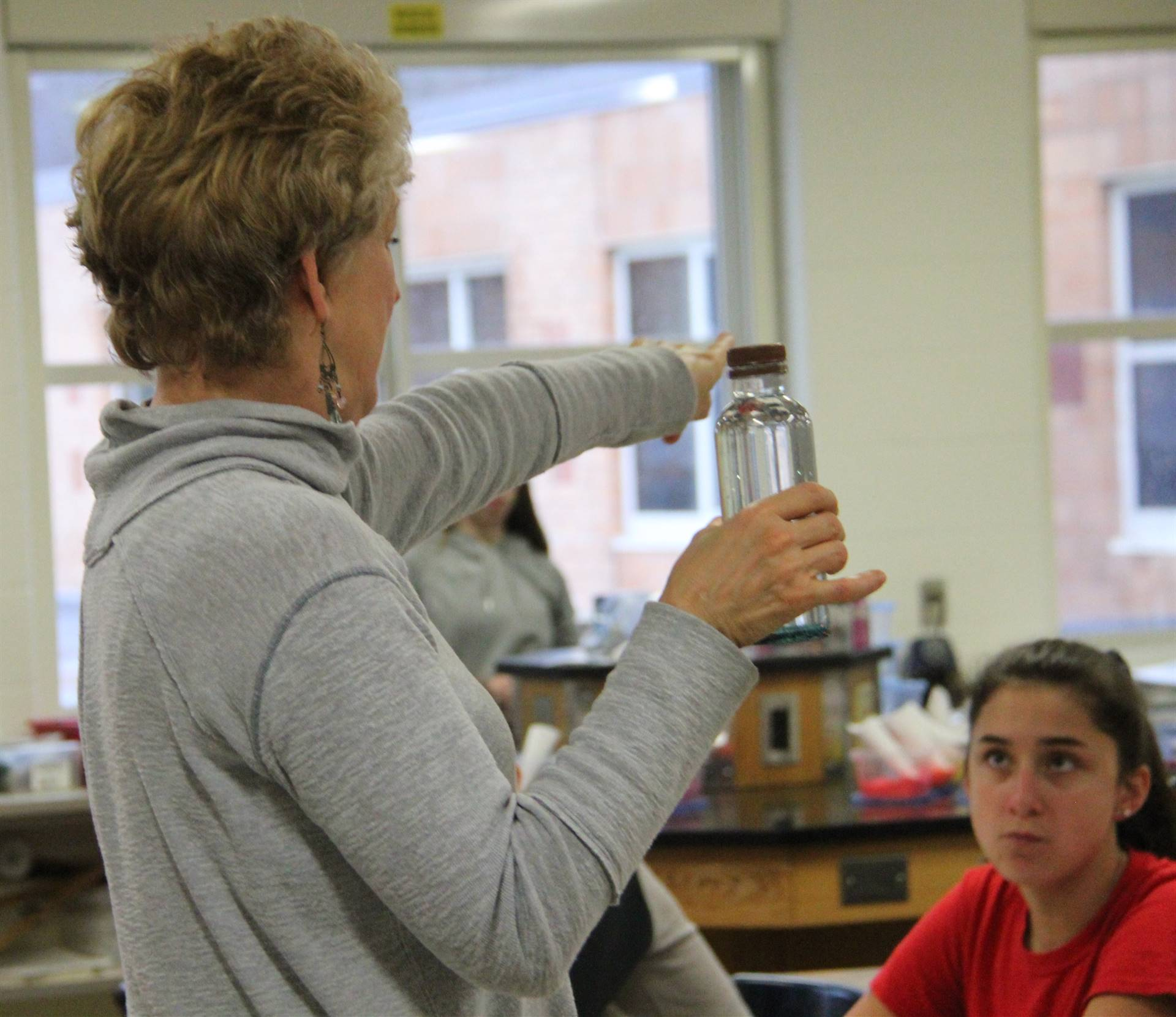 miss ann showing students mindfulness bottle