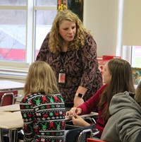 assistant superintendent speaking with students