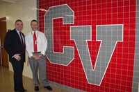 principal attleson and senator akshar next to c v sign