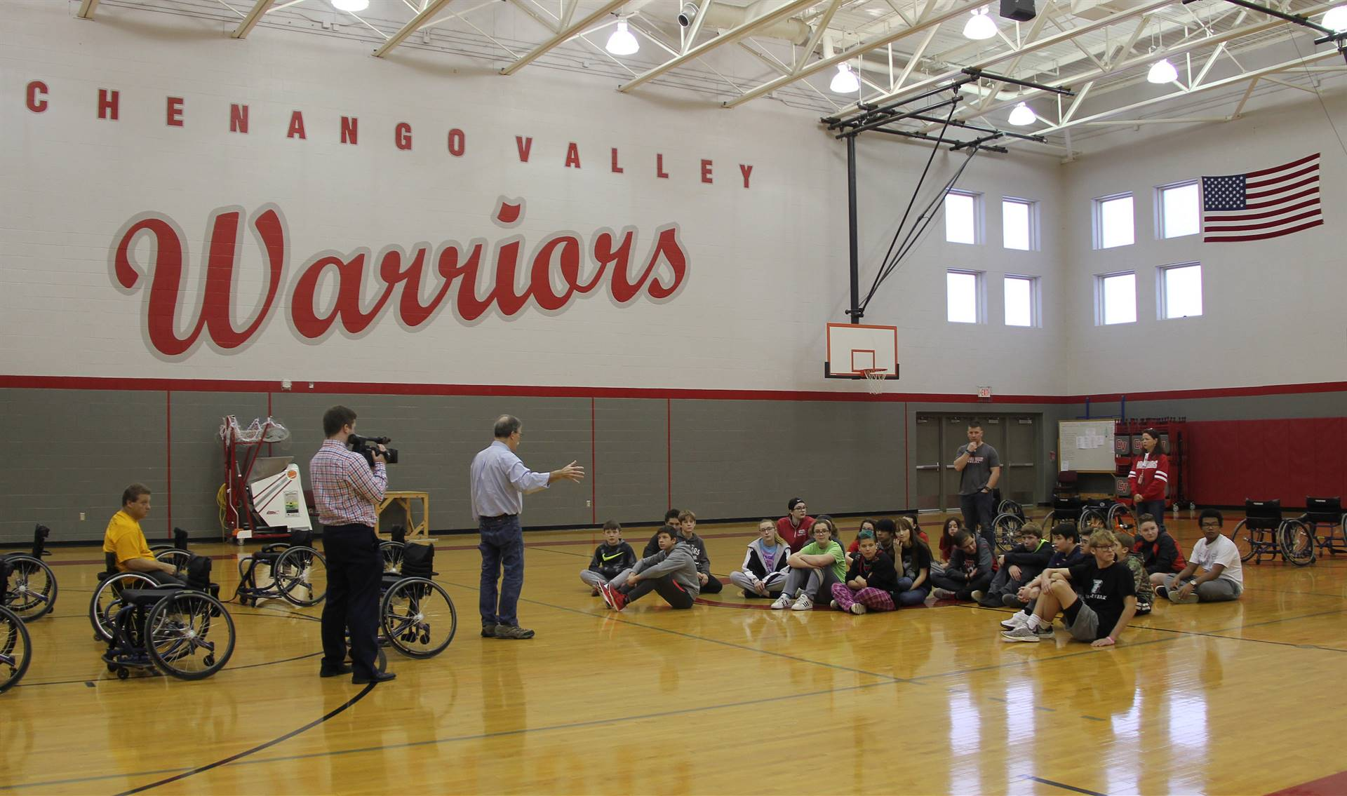 instructor explaining wheelchair activities to students