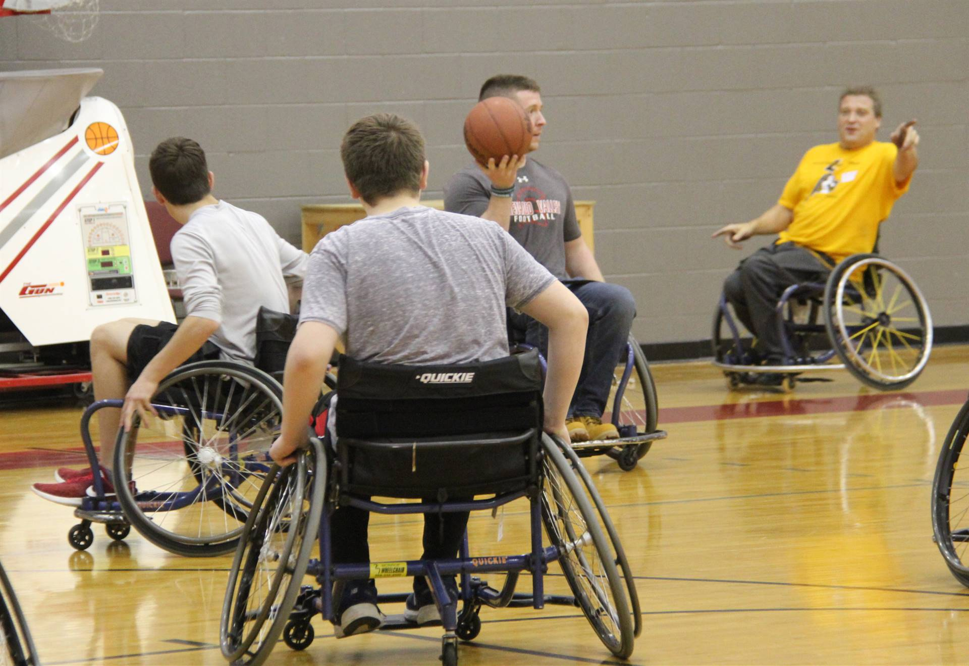 teachers students and instructor taking part in wheelchair basketball
