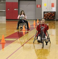 students participating in wheelchair bicycle activity