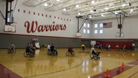 wide shot of students taking part in wheelchair basketball