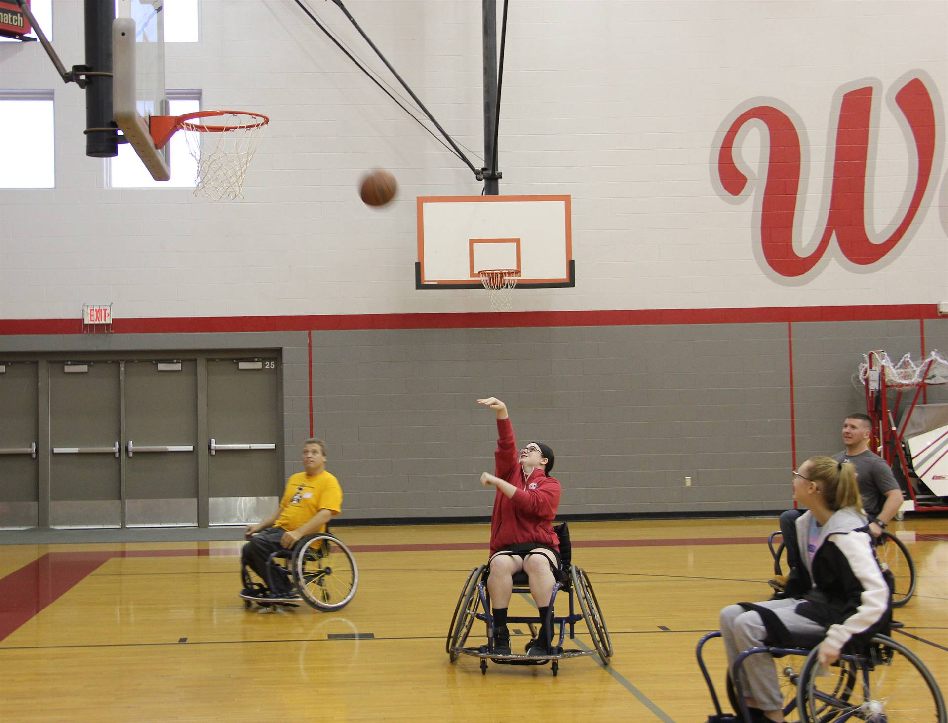 students taking part in wheelchair basketball