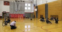 wide shot of students taking part in wheelchair activities