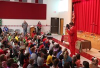 teacher speaking to students at holiday sing along