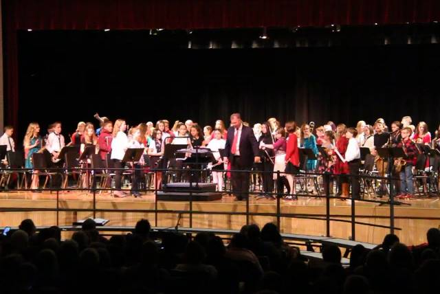 wide shot of band bowing after performance