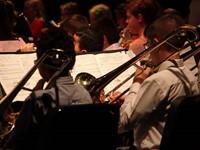 medium shot of students playing instruments
