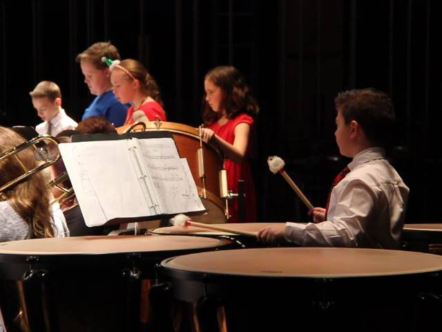 students playing instruments at back of stage