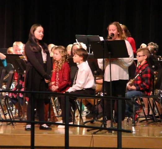 students speaking at winter concert