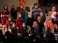 medium shot of students singing