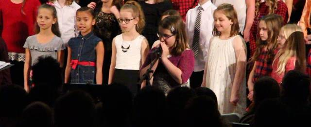 another student speaking at winter concert