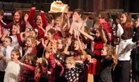 medium shot of students performing at winter concert